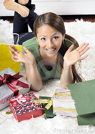 Happy young woman with gift boxes