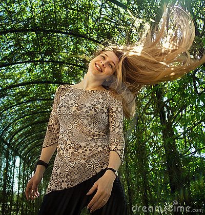 Happy young woman with hair in motion