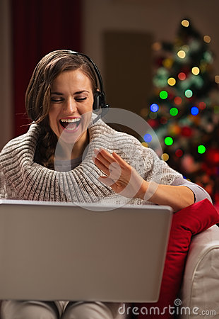 Happy young woman having video chat with family