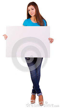 Happy young woman holding a blank billboard