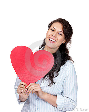 Happy young woman holding a red heart