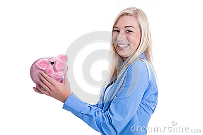 Happy young woman isolated with a pink piggy bank.