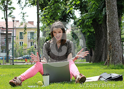 Happy Young Woman on a Laptop