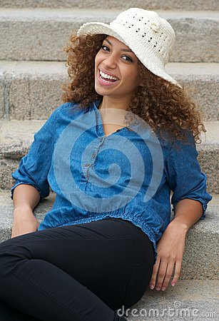 Happy young woman laughing outdoors