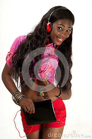 young woman listening to music with headphone