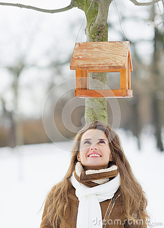 Free Happy Young Woman Looking On Bird Feeder On Tree Royalty Free Stock Photo - 29129165
