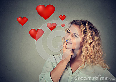 Happy young woman in love daydreaming about romance Stock Photo
