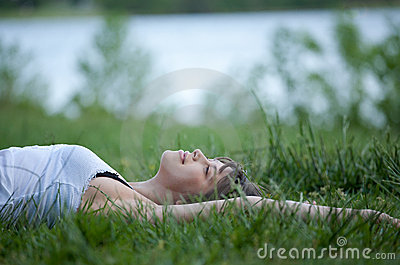 Happy Young Woman Lying in Field