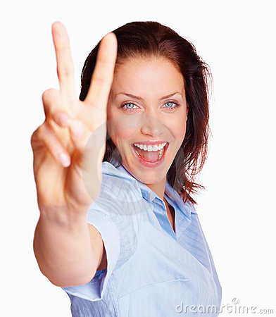 Happy young woman making peace sign on white