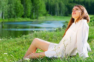 Happy young woman on nature
