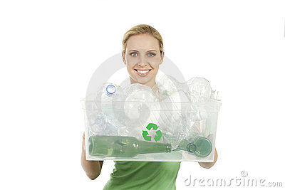 Happy young woman recycling