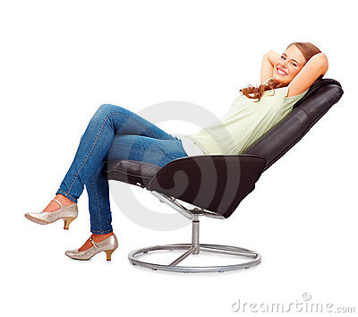 Happy young woman relaxing on an office chair