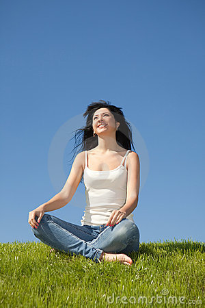 Happy young woman rest on the grass