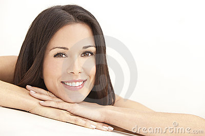 Happy Young Woman Resting on Hands in Spa