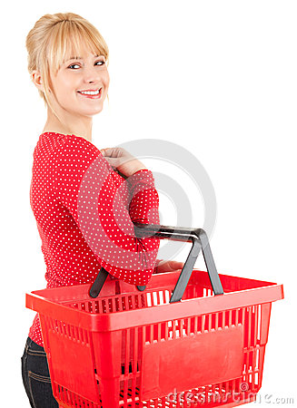 Happy young woman with shopping basket