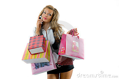 Happy young woman on a shopping spree.