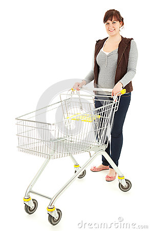 Happy young woman with shopping trolley