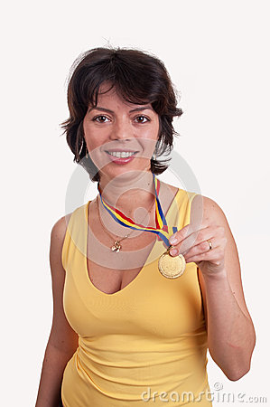 Happy young woman showing her gold medal