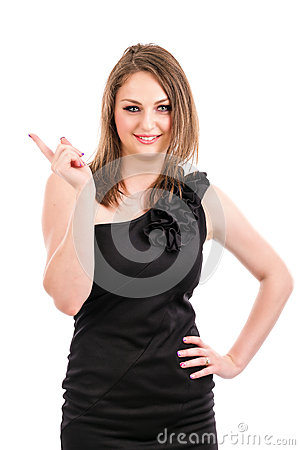 Happy young woman showing something with her finger