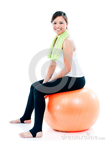 Happy Young Woman Sitting On Balance Ball