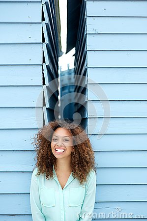 Happy young woman smiling with joyful expression