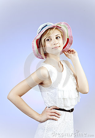 Happy young woman in straw hat