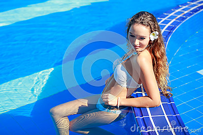 Happy young woman in swimming pool