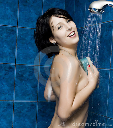 Happy young woman taking a shower