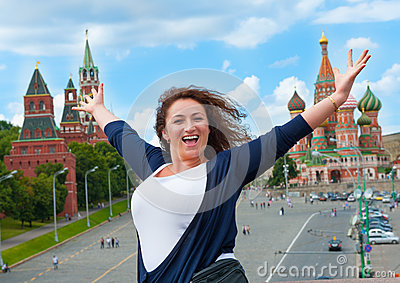 Happy young woman tourist visiting Moscow