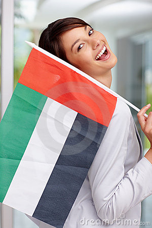 Happy young woman with a United Arab Emirates flag