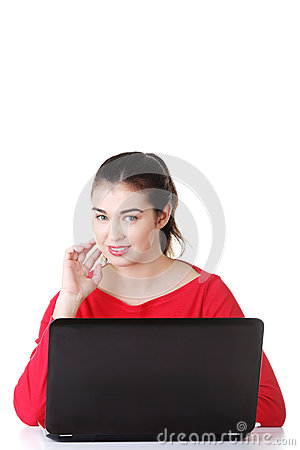 Happy young woman using her laptop.