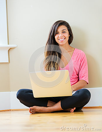 Happy young woman using a laptop computer