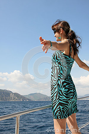 Happy young woman on yacht