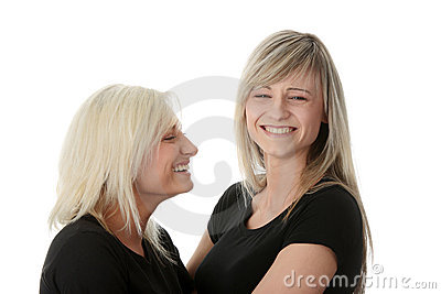 Happy young women friends laughing