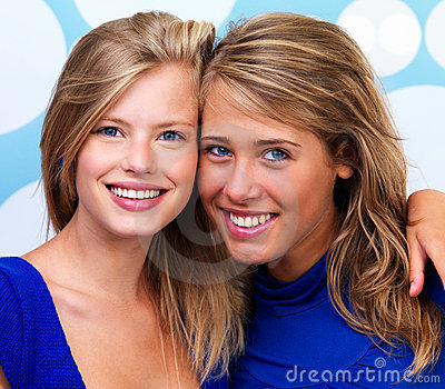 Happy young women looking at camera