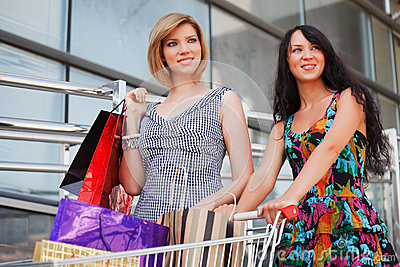 Happy young women shopping