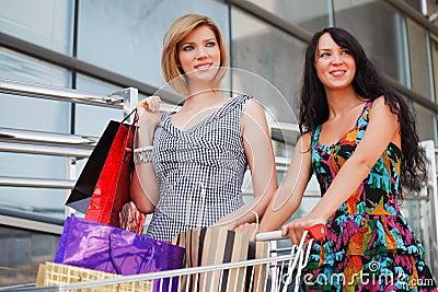Happy young women shopping