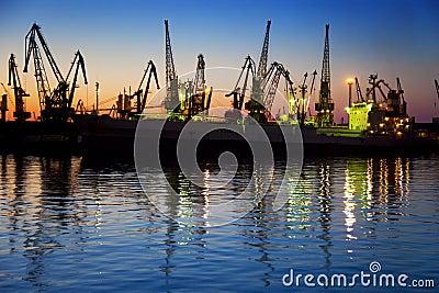 Harbor / Cargo / Silhouette of  Cranes at Sunset