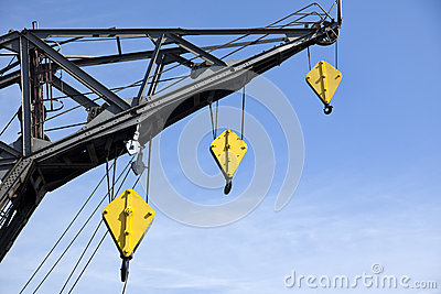 Harbor crane with yellow hooks