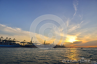 Harbor with a golden sunrise view- Singapore.