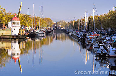 Harbour on autumn morning with blue sky