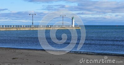 Harbour entrance at Oshawa, Ontario, Canada with lighthouse 4K. The Harbour entrance at Oshawa, Ontario, Canada with lighthouse 4K stock footage