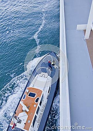 Harbour Pilot climbing onto ship Pilot Tender Editorial Stock Photo