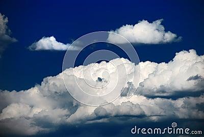 Hard clouds against blue sky