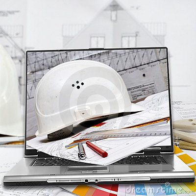 Hard hat, house plans and laptop