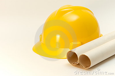 Hard hat and rolled plans