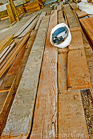 A hard hat on wood planks