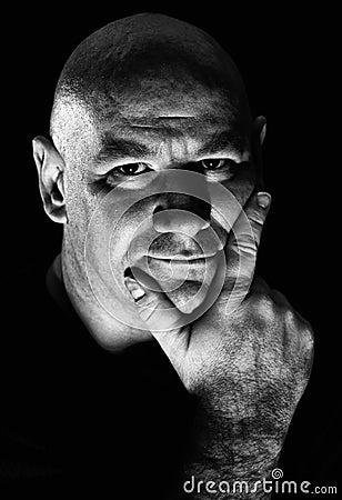 Hard light portrait of middle aged man
