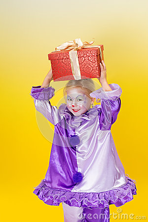 Harlequin clown with present