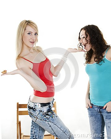 Harmonious girl treats the friend with cakes